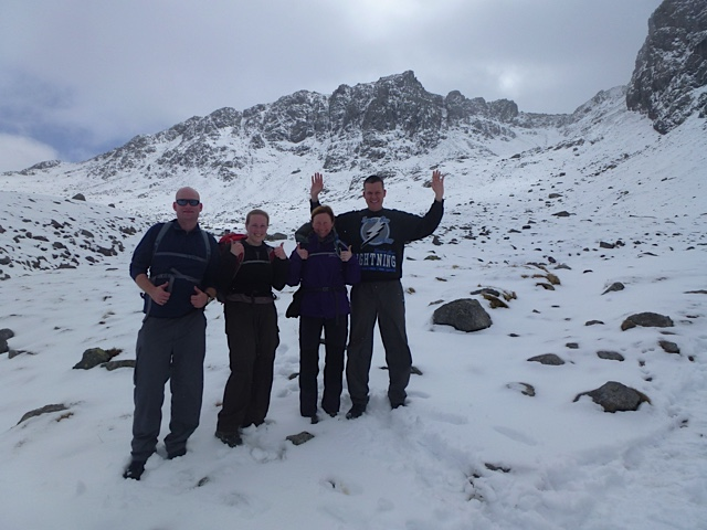 Team looking happy on the way up, Pikes Crag in the background